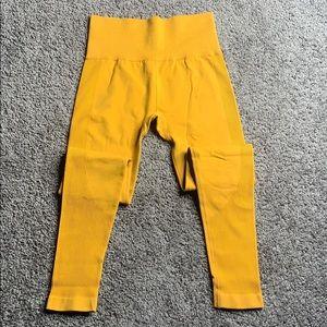 body fitting yellow leggings